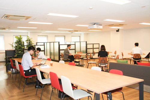 Eighth floor open area equipped with tables, counters, meeting spaces, and large displays 2
